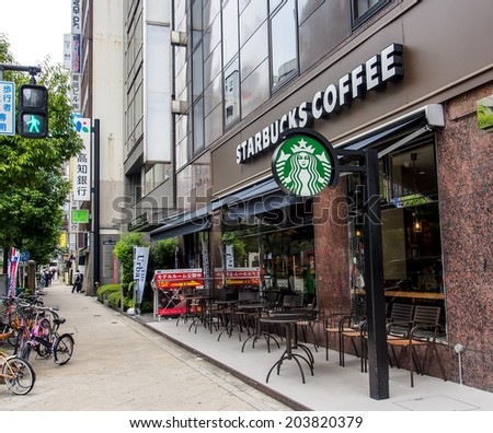 OSAKA - APRIL 20: Starbucks coffee shop in Shinsaibashi business area on April 20, 2014 in Osaka, Japan. The first store of Starbucks outside the USA or Canada opened in Tokyo, Japan in 1996