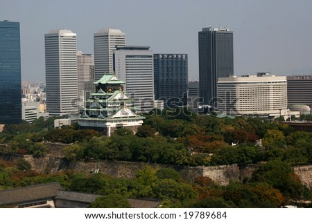 Osaka castle aerial view with modern skyscrapers in the background, Japan - stock photo