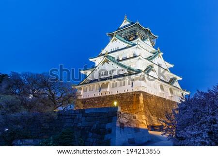 Osaka castle and cherry blossom - stock photo
