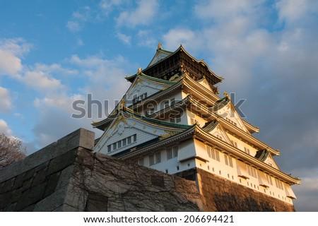 Osaka Castle at Sunset - stock photo