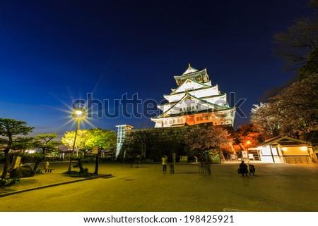 Osaka castle at twilight - stock photo