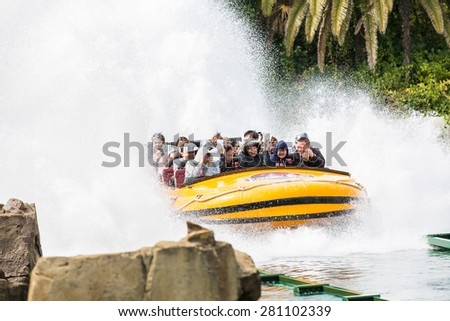 Osaka, Japan - Apr 9: Excited People Taking Boat Water Attraction Sliding from the Steep Slope at Universal Globe outside the Universal Studios Theme Park in Osaka, Japan on Apr 9, 2015 - stock photo