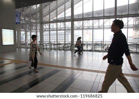 OSAKA, JAPAN - APRIL 25: People hurry at Osaka Station on April 25, 2012 in Osaka, Japan. It is the 3rd busiest station in the world serving average 2.4 million passengers daily.