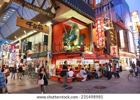 OSAKA, JAPAN - APRIL 24: Shoppers walk near Shinsaibashi street on April 24, 2012 in Osaka, Japan. According to Tripadvisor, it is currently among top 10 worth visiting places in Osaka.