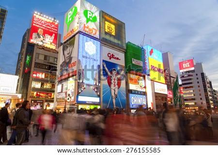 OSAKA, JAPAN - APRIL 21 : The Glico Man light billboard and other light displays on April 21,2015 in Dontonbori, Namba area, Osaka, Japan. Namba is well known as an entertainment area in Osaka. - stock photo