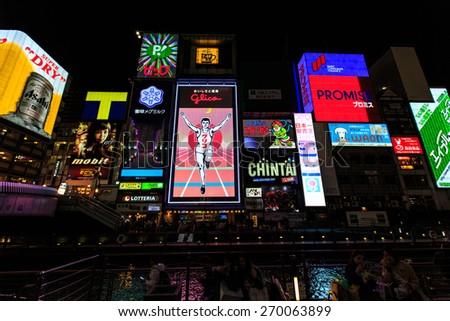 OSAKA, JAPAN - APRIL 12: The Glico Man light billboard and other light on Aprir 12 2015 in Dontonbori, Namba area, Osaka, Japan. Namba is now primary tourist destination. - stock photo