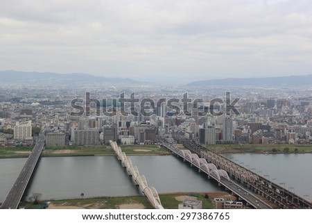 Osaka, Japan - April 8, 2015: The Yodo River, whose source of the river is Lake Biwa in Shiga Prefecture to the north, is the principal river in Osaka Prefecture on Honshu, Japan.