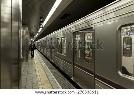 OSAKA, JAPAN - APRIL 23 : train approaches at Osaka Namba train station on April 23,2015 in Osaka, Japan. Osaka Namba exists since 1970 and was used by average 150,000 passengers daily in 2010. - stock photo