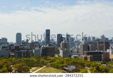 OSAKA, JAPAN - APRIL 21 : view of hi-rise building in Osaka city from Osaka castle on April 21,2015 in Japan.