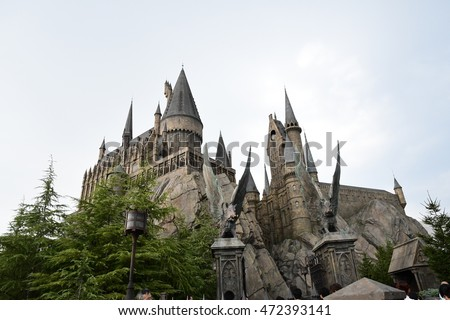 OSAKA, JAPAN - August 14, 2016 Photo of Hogwarts Castle and its reflection on the lake's surface taken from Hogsmeade side in the Wizarding World of Harry Potter theme park, Universal Studio Japan.
