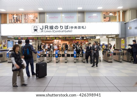 OSAKA, JAPAN CIRCA APRIL 2016:People passes the gate. Commuter trains are the main mode of transportation in Tokyo. - stock photo