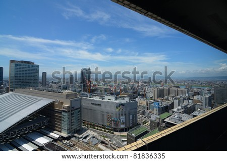 OSAKA, JAPAN - JULY 9: The newly rebuilt Osaka Station in Umeda is the largest transit hub in Western Japan and hosts upscale shops and fine dining establishments July 9, 2011 in Osaka, Japan. - stock photo