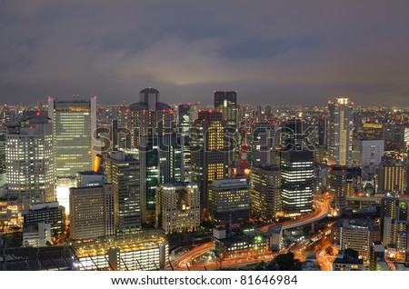 OSAKA, JAPAN - JULY 12: The ratio between daytime and night time population in Osaka is 141%, the highest in Japan, highlighting its status as an economic center July 12, 2011 in Osaka, Japan. - stock photo