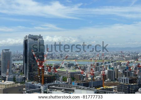 OSAKA, JAPAN - JULY 9: Umeda skyline on July 9, 2011 in Osaka, Japan. Umeda is the main commercial and central business district of Osaka and is currently under rapid development. - stock photo