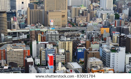 OSAKA, JAPAN - JULY 13 : With a Metropolitan area of nearly 18 million people, Osaka is Japan's second largest city July 13, 2011 in Osaka, Japan. - stock photo