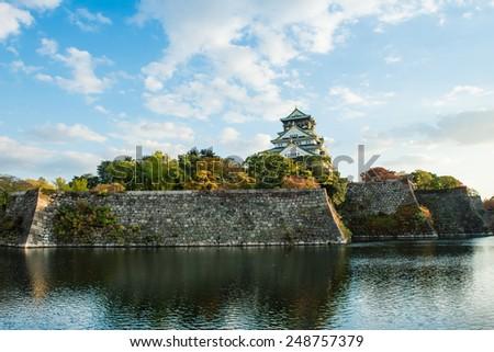 OSAKA, JAPAN - JUNE 15, 2013: View of Osaka castle. Many tourists visit this place.  - stock photo