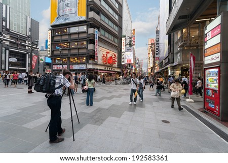 OSAKA, JAPAN - MAY 28, 2008: Dotonbori street is one of the main attractions of Osaka. Street is very popular among tourists and locals, here are the many restaurants and cafes, shops and nightlife.