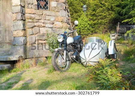 Osaka, Japan - May 2:Hagrid's motorbike and background home Hagrid  at Universal Japan the Harry Potter themed attractions in the Universal Studios Theme Park in Osaka, Japan on May 2 , 2015. - stock photo