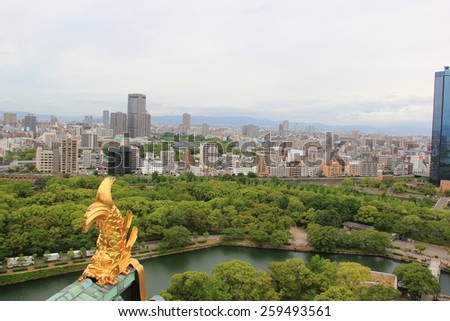 Osaka, Japan - May 28, 2013: Scenery of Osaka with Shachihoko, sign of prestige and authority of the castle lord and were thought to protect the castle from fire, on the roof ridge of Osaka Castle. - stock photo