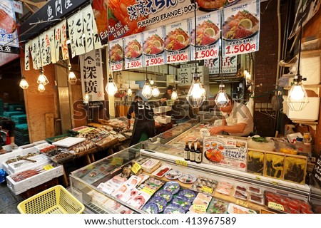 OSAKA, JAPAN - NOV 6: Tourists shopping and visit seafood prices in shop in shop  in Kuromon Ichiba market on November 6, 2015 in Osaka, Japan. it is market places popular in Osaka
