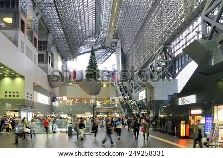 OSAKA, JAPAN - NOVEMBER 9, 2014 : Osaka Station is located in Umeda District, Kita-ku, Osaka, Japan. It contains contains entertainment, restaurants and shops November 9, 2014 Osaka,Japan - stock photo