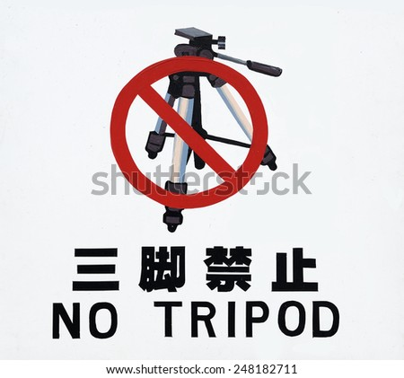 OSAKA, JAPAN-NOVEMBER 5, 2014; Sign of prohibition of photo camera on tripod with text in English and Japanese. November 5, 2014, Osaka, Japan - stock photo