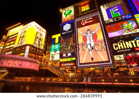 OSAKA, JAPAN - NOVEMBER 24: The Glico Man light billboard and other light displays on November 24, 2014 in Dontonbori, Namba area, Osaka, Japan. Namba is well known as an entertainment area in Osaka.