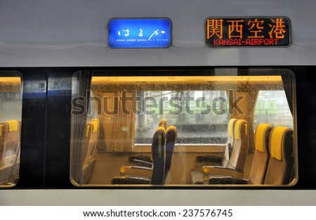 OSAKA,JAPAN-NOVEMBER 2, 2014; Train to Kansai-Airport in Osaka, Japan with sign in english language and japanese.This line is called the Kansai Airport Express. November 2,2014 Osaka,Japan - stock photo