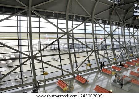OSAKA,JAPAN-NOVEMBER 12, 2014; Travelers and airplanes at Kansai International Airport. This is the Osaka International Airport. November 12, 2014 Osaka, Japan  - stock photo