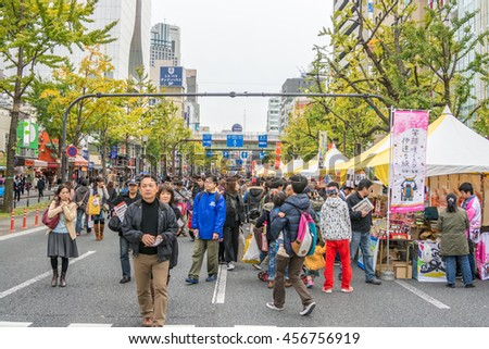 Osaka, Japan - November 29, 2015:Unidentified People visit Dotonbori street in Osaka . One of the famous tourist spots in Osaka. People come to see the billboards and well design shop logo
