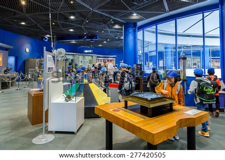 OSAKA, JAPAN - OCTOBER 28: Science Museum in Osaka, Japan on October 28, 2014. Unidentified group of Japanese students are on a field trip at Osaka Science Museum - stock photo