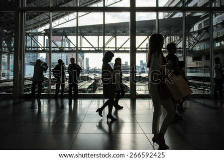 OSAKA, JAPAN - OCTOBER 12, 2014: Silhouette of people in Osaka station.