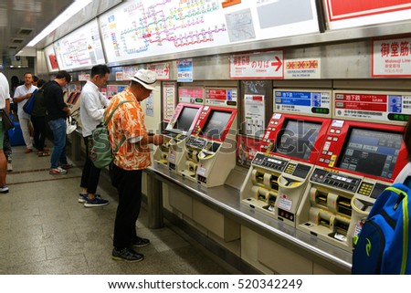 OSAKA, JAPAN - SEPTEMBER 25 2016: Passenger Purchase The Train Ticket from Automatic Vending Machine at Namba Station