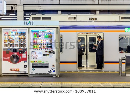 OSAKA - OCT 29, 2013: Two man reading a book at the underground railways station in October 29, 2013 ,japan - stock photo