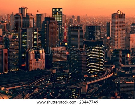 Osaka skyline at sunset - view from Umeda Sky Building - stock photo