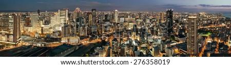Osaka urban city at night panorama rooftop view. Japan. - stock photo