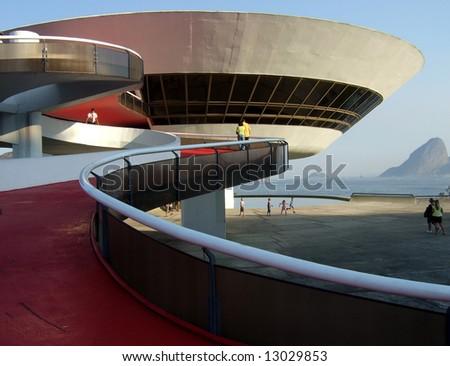 Oscar Niemeyer's Niterói Contemporary Art Museum and Sugar Loaf, in Rio de Janeiro, Brazil - stock photo