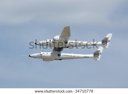 OSHKOSH, WI - JULY 28:  Virgin Galactic WhiteKnightTwo, or Eve in flight at EAA AirVenture July 28, 2009 in Oshkosh, Wisconsin. - stock photo
