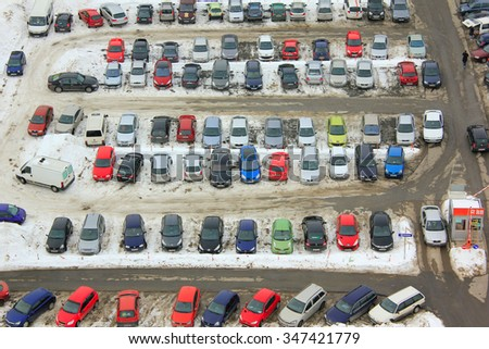 OSIJEK, CROATIA - December 22: Parking lot with many cars in winter, on December 22, 2013 in Osijek, Croatia. - stock photo