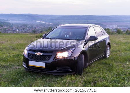 OSINNIKI - MAY 19 2015: Car Chevrolet Cruze on nature on May, 2015 in Osinniki, Russia.