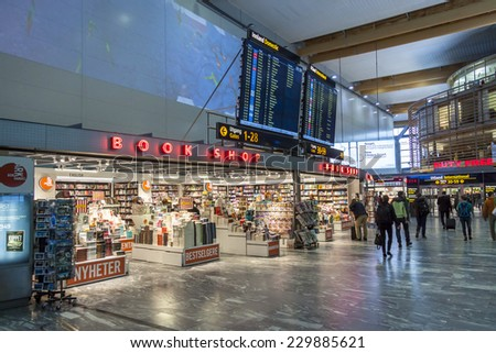 OSLO GARDERMOEN, NORWAY -  NOVEMBER 3:Interior of Duty Free Shop at Oslo Gardermoen International Airport on november 3, 2014 in Oslo. The airport has biggest passenger flow in Norway. - stock photo