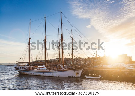 Oslo harbor with boats and yachts at twilight. There are both private and touristic boats, and on background some modern buildings. - stock photo