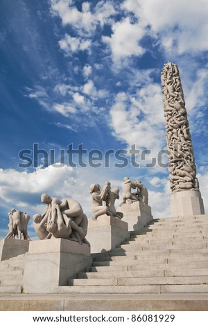 OSLO - JUNE 30: The Monolith is the highest point of Gustav Vigeland's Sculpture Park on June 30, 2009 in Oslo, Norway. The Monolith consists of 121 human figures and stands 14.12 meters (46.32 ft) tall. - stock photo