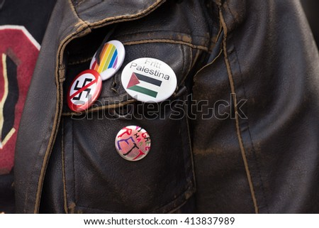 "OSLO - MAY 1: An activist wears a pin saying ""Free Palestine"" in Norwegian among anti-fascist and gay rights symbols during the May Day parade in Oslo, Norway, May 1, 2016."