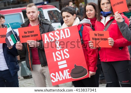 OSLO - MAY 1: Syrian refugees protest President Bashar al-Assad during the May Day parade in Oslo, Norway, May 1, 2016. - stock photo