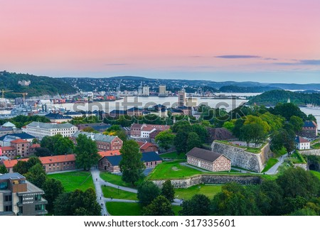 Oslo, Norway. A view at Oslofjord and Akershus fortress from the top of City hall (Radhuset) tower. Taken on 2015/09/11 - stock photo