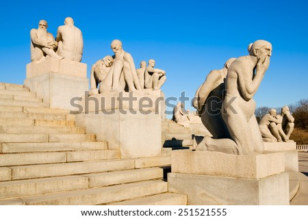 "OSLO, NORWAY - APRIL 12, 2010: The Vigeland Park. Sculptures of Gustav Vigeland. Fragment of the Monolith composition. Foreground is sculpture  ""Two old women"""