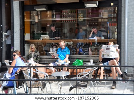 OSLO, NORWAY - AUGUST 16: Unidentified people having lunch in the cafe on 16 August 2012 in Oslo, Norway. - stock photo