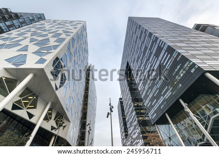 OSLO, NORWAY - DECEMBER 31, 2014: New apartment blocks called 'Barcode buildings' in Oslo, Norway. The Barcode buildings are a redevelopment on former dock and industrial land in central Oslo. - stock photo