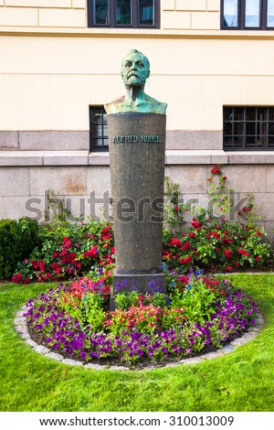 OSLO, NORWAY - JULY 7: Alfred Nobel statue in front of the Norwegian Nobel Institute on July 7 2015 in Oslo, Norway. - stock photo